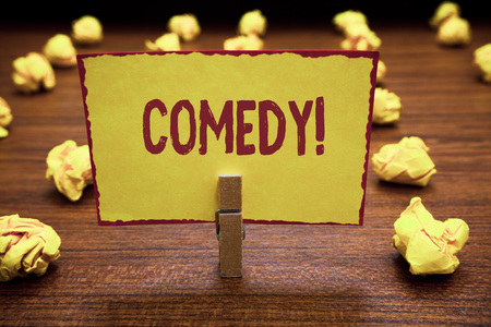 Word writing text Comedy. Business concept for Professional entertainment Jokes Sketches Make audience laugh Humour Clothespin holding yellow paper note crumpled papers several tries mistakes