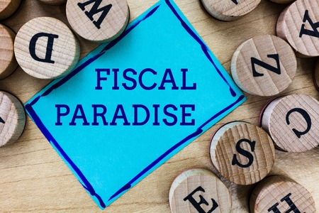 Word writing text Fiscal Paradise. Business concept for The waste of public money is a great concern topic. Standard-Bild