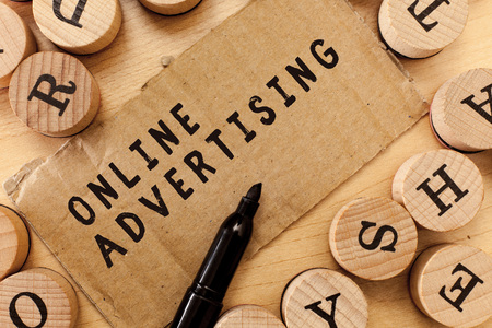 Handwriting text writing Online Advertising. Concept meaning Internet Web Marketing to Promote Products and Services.