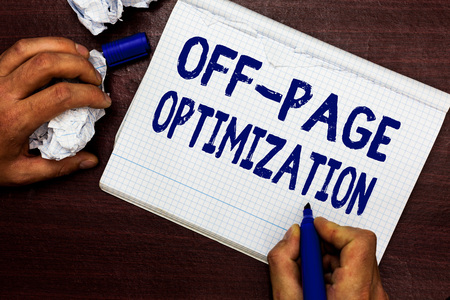 Writing note showing Off Page Optimization. Business photo showcasing Website External Process Promotional Method Ranking Man holding marker notebook page crumpled paper several tries mistakes