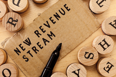 Handwriting text writing New Revenue Stream. Concept meaning Additional Enhanced Source of Income Improved Approach. Zdjęcie Seryjne