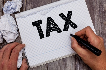Handwriting text Tax. Concept meaning Compulsory contribution to state revenue Levy impose by government. Reklamní fotografie