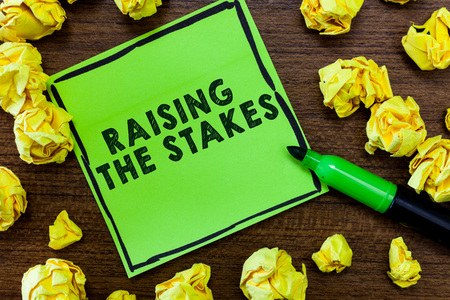 Text sign showing Raising The Stakes. Conceptual photo Increase the Bid or Value Outdo current bet or risk.