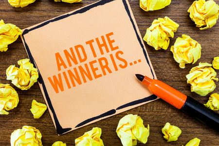 Writing note showing And The Winner Is.... Business photo showcasing Announcing who the Victor is Exemplar Achiever.