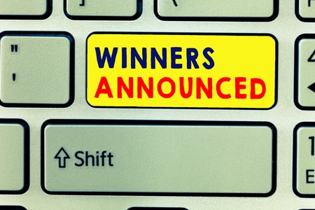 Handwriting text writing Winners Announced. Concept meaning Announcing who won the contest or any competition. 写真素材
