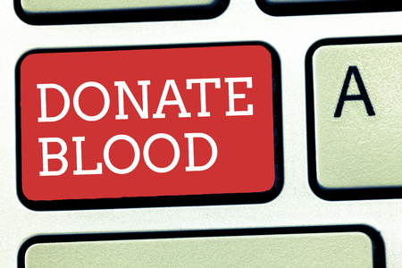 Text sign showing Donate Blood. Conceptual photo Refers to the collection of blood commonly from donors. Foto de archivo