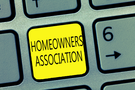 Handwriting text writing Homeowners Association. Concept meaning Organization with fee for upkeeps of Gated Community.