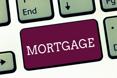 Writing note showing Mortgage. Business photo showcasing agreement by which bank lends money interest exchange for property.