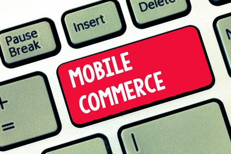 Handwriting text writing Mobile Commerce. Concept meaning Using mobile phone to conduct commercial transactions online.