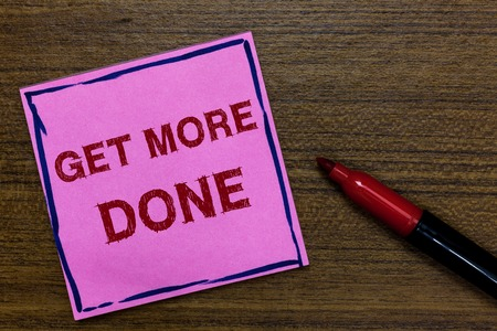 Text sign showing Get More Done. Conceptual photo Checklist Organized Time Management Start Hardwork Act Purple Paper Important reminder Communicate ideas Marker Wooden background 版權商用圖片
