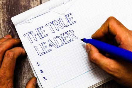 Handwriting text writing The True Leader. Concept meaning one that move and encourage group of people Responsibility. 스톡 콘텐츠