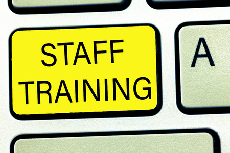 Conceptual hand writing showing Staff Training. Business photo text A program that helps employees to learn specific knowledge.