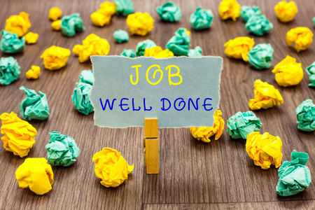 Text sign showing Job Well Done. Conceptual photo Well Performed You did it Cheers Approval Par Accomplished Clothespin holding gray note paper crumpled papers several tries mistakes