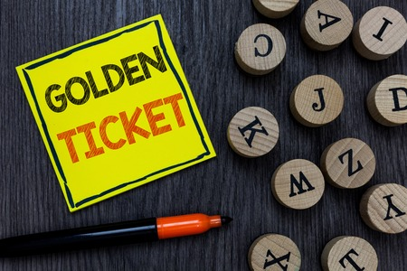 Conceptual hand writing showing Golden Ticket. Business photo showcasing Rain Check Access VIP Passport Box Office Seat Event Yellow paper circle Marker express ideas wooden background Standard-Bild