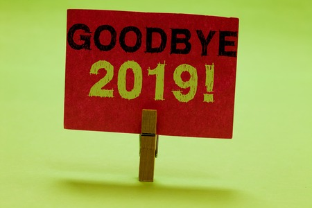 Text sign showing Goodbye 2019. Conceptual photo New Year Eve Milestone Last Month Celebration Transition Clothespin holding red paper important communicating messages ideas