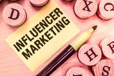 Handwriting text writing Influencer Marketing. Concept meaning Endorser who Influence Potential Target Customers.