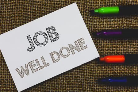 Handwriting text Job Well Done. Concept meaning Well Performed You did it Cheers Approval Par Accomplished White Paper Important reminder Communicate ideas Markers Jute background