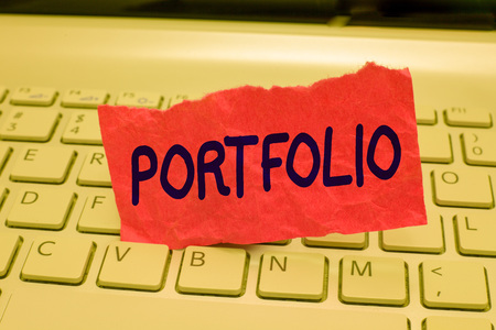 Writing note showing Portfolio. Business photo showcasing Examples of work used to apply for a job Combination of shares. 免版税图像