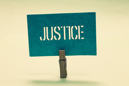 Handwriting text Justice. Concept meaning Quality of being just impartial or fair Administration of law rules Clothespin holding turquoise paper important communicate message ideas
