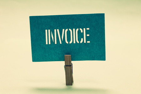 Handwriting text Invoice. Concept meaning List of goods sent services provided with sums Financial statement Clothespin holding turquoise paper important communicate message ideas