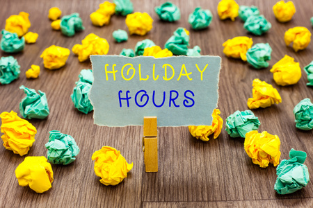 Text sign showing Holiday Hours. Conceptual photo Schedule 24 or 7 Half Day Today Last Minute Late Closing Clothespin holding gray note paper crumpled papers several tries mistakes Stock Photo