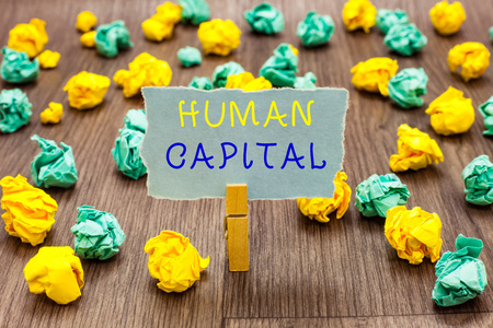 Text sign showing Human Capital. Conceptual photo Intangible Collective Resources Competence Capital Education Clothespin holding gray note paper crumpled papers several tries mistakes