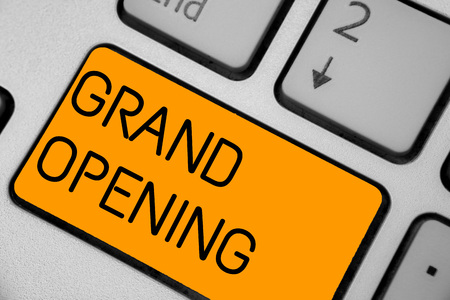 Handwriting text Grand Opening. Concept meaning Ribbon Cutting New Business First Official Day Launching Keyboard orange key Intention create computer computing reflection document Stock Photo