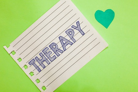 Word writing text Therapy. Business concept for Treatment intended to relieve or heal a disorder Healthcare Notebook piece paper reminder heart romantic messages green background