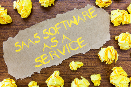 Word writing text Saas Software As A Service. Business concept for the use of cloud based App over the Internet.