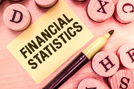 Handwriting text writing Financial Statistics. Concept meaning Comprehensive Set of Stock and Flow Data of a company. Stock Photo