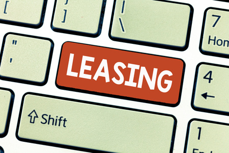 Conceptual hand writing showing Leasing. Business photo showcasing Grant on lease Rent Agreement between two parties Contract.