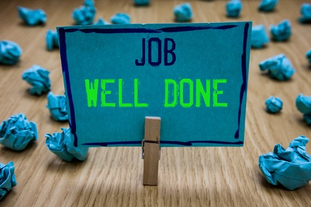 Handwriting text writing Job Well Done. Concept meaning Well Performed You did it Cheers Approval Par Accomplished Clothespin holding blue paper note crumpled papers several tries mistakes