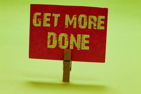 Text sign showing Get More Done. Conceptual photo Checklist Organized Time Management Start Hardwork Act Clothespin holding red paper important communicating messages ideas Foto de archivo