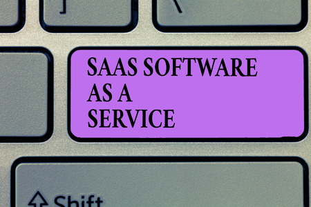 Writing note showing Saas Software As A Service. Business photo showcasing the use of cloud based App over the Internet.