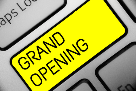 Conceptual hand writing showing Grand Opening. Business photo text Ribbon Cutting New Business First Official Day Launching Keyboard yellow key computer computing reflection document