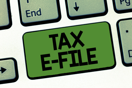 Text sign showing Tax E File. Conceptual photo System submitting tax documents to US Internal Revenue Service. 免版税图像
