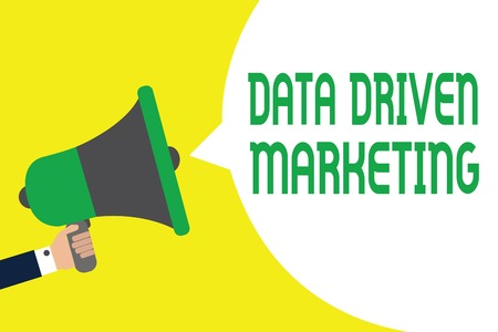 Writing note showing Data Driven Marketing. Business photo showcasing Strategy built on Insights Analysis from interactions Man holding megaphone loudspeaker speech bubble message speaking loud Stock Photo