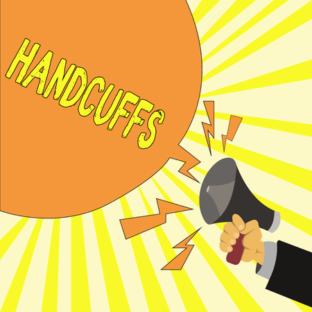 Text sign showing Handcuffs. Conceptual photo Pair of lockable linked metal rings for securing a prisoner. Stock Photo
