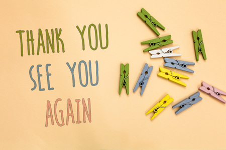 Text sign showing Thank You See You Again. Conceptual photo Appreciation Gratitude Thanks I will be back soon Yellow base with painted texts colorful paper clips laid randomly on ground