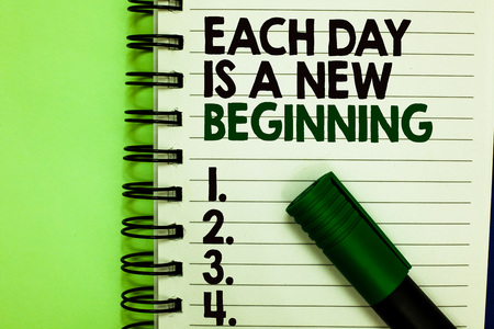 Handwriting text Each Day Is A New Beginning. Concept meaning Every morning you can start again Inspiration Written letters and numbers on notepad laid green marker green back Archivio Fotografico