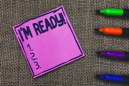 Conceptual hand writing showing I am Ready. Business photo showcasing To be prepared for doing something Readiness Preparation Purple Paper Important reminder Markers Jute background
