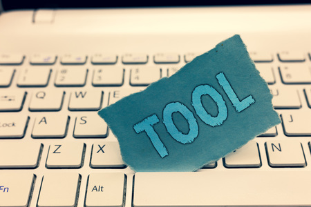 Writing note showing Tool. Business photo showcasing A thing used in an occupation Device that carries out function. 写真素材