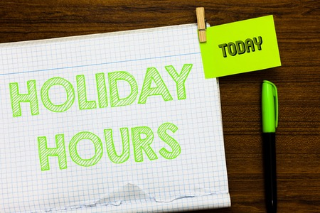 Writing note showing Holiday Hours. Business photo showcasing Schedule 24 or 7 Half Day Today Last Minute Late Closing Open notebook page markers holding paper heart wooden background