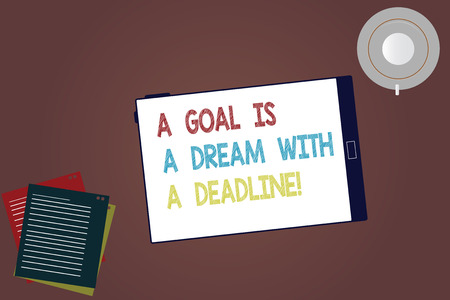 Word writing text A Goal Is A Dream With A Deadline. Business concept for Set times to your objectives Motivation Tablet Empty Screen Cup Saucer and Filler Sheets on Blank Color Background