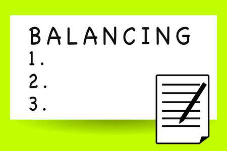 Handwriting text writing Balancing. Concept meaning put something in a steady position so that it does not fall Sheet of Pad Paper with Lines and Margin Ballpoint Pen on top Flip corner Stock Photo