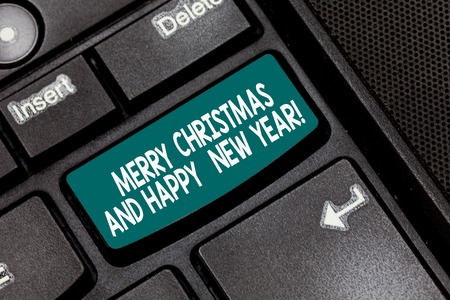 Conceptual hand writing showing Merry Christmas And Happy New Year. Business photo text Holiday season greetings celebrations Keyboard key Intention to create computer message idea Stock Photo