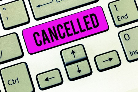 Conceptual hand writing showing Cancelled. Business photo showcasing decide or announce that planned event will not take place Keyboard Intention to create computer message keypad idea