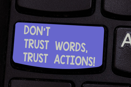 Text sign showing Don T Trust Words Trust Actions. Conceptual photo Less talking more things done action taken Keyboard key Intention to create computer message pressing keypad idea