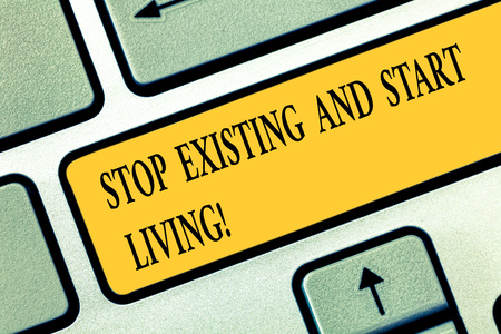 Conceptual hand writing showing Stop Existing And Start Living. Business photo text Enjoy have more leisure family moments Keyboard key Intention to create computer message idea Фото со стока