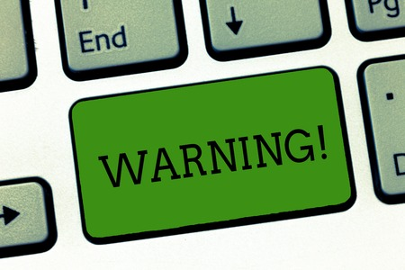 Conceptual hand writing showing Warning. Business photo showcasing statement or event that warns of something or serves as example Keyboard Intention to create computer message keypad idea